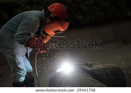welder working in the street