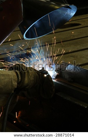 welder working on a metal structure