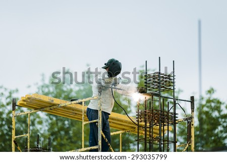 welder working with electrode - stock photo