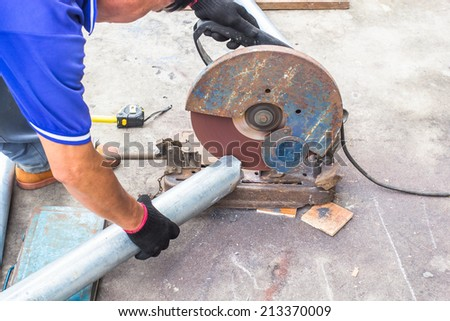 Welders cutting pipe to be used for the connection. - stock photo
