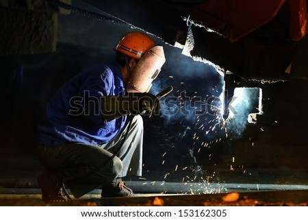 Welders in repair - stock photo