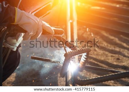 Welders welding - stock photo