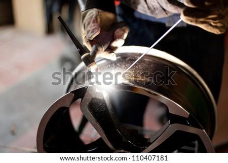 Welding alloy rim. Alloy wheel repair - stock photo