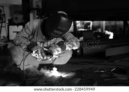 Welding and bright sparks. - stock photo