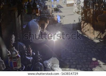 Welding in the souks of Marrakesh - stock photo