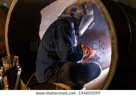 welding inside the pipe - stock photo
