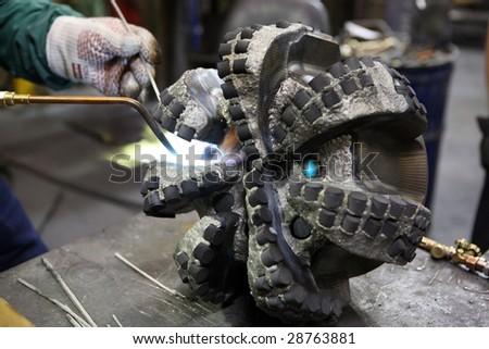 Welding job in repair facility - stock photo