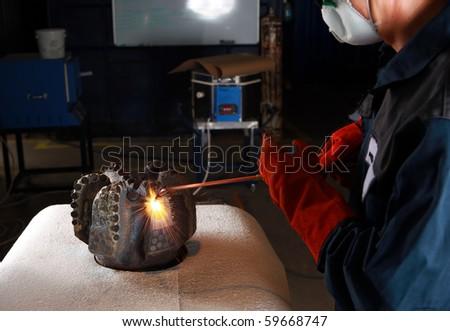 Welding job in repair facility. - stock photo