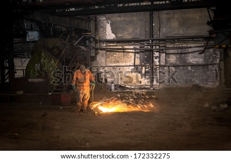 Welding manwith sparks - stock photo