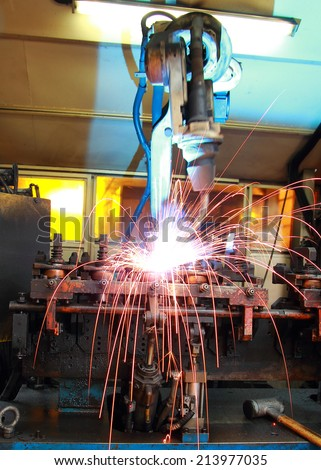 Welding Robot Machine Automotive Industry - stock photo