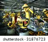 welding robots in a car manufactore - stock photo