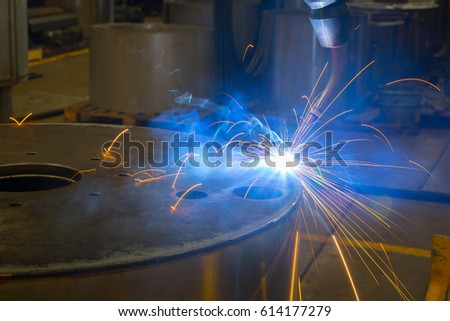 Welding robots movement in factory close up
