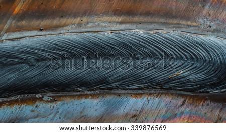welding seam onto steel sheet metal Industrial steel welder in factory  - stock photo