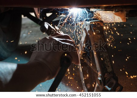 Welding the car body after the accident - stock photo