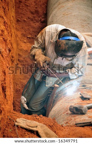 welding water pipes - stock photo