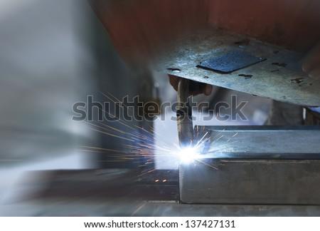 welding with mig-mag method - stock photo