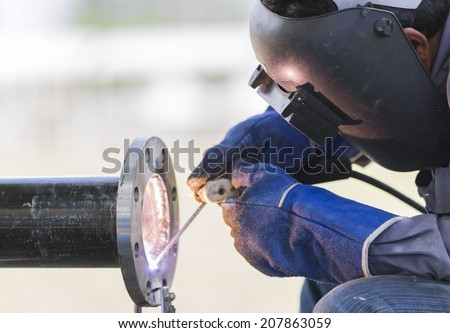 welding work and piping - stock photo