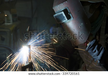 Welding work with sparking fire - stock photo
