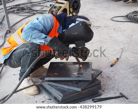 Welding work, worker with protective welding metal on construction site