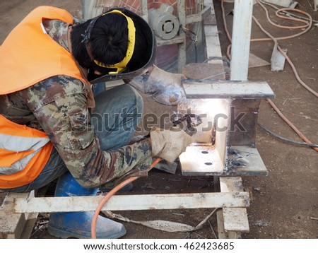 Welding work,worker with protective welding metal on construction site