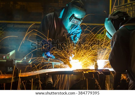 welding worker in the automotive part in Industrial