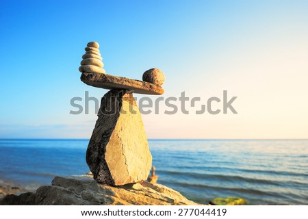 Well-balanced of pebbles on the top of stone - stock photo