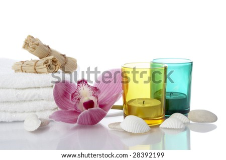 well being concept with towel, candle and plants on white background - stock photo