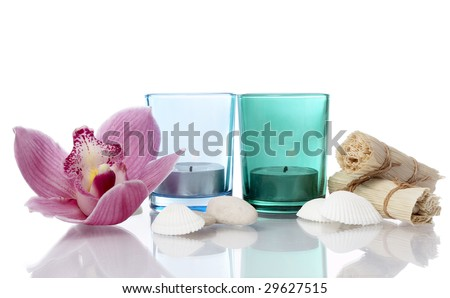 well being concept with towel, candle and plants on white background