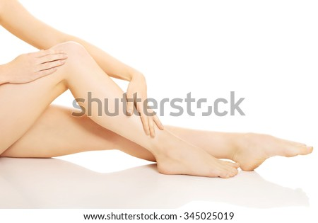 Well being slim woman massaging her leg. - stock photo