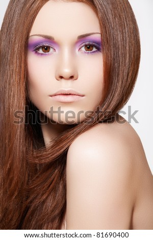 Well-being & spa. Beautiful model with shiny and healthy brown hair, straight hairstyle. Clean soft skin, bright summer violet make-up - stock photo