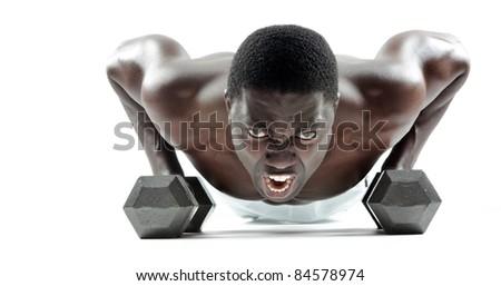 Well built muscular man doing press-ups - stock photo