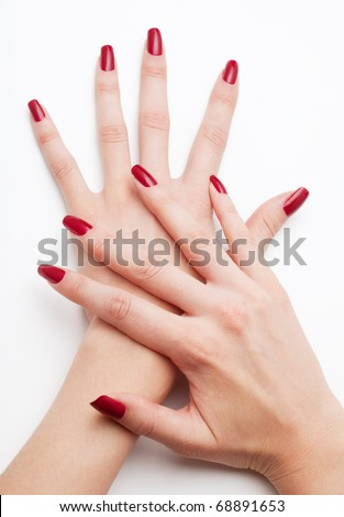 Well cared woman's hands on white with well painted fingernails - stock photo
