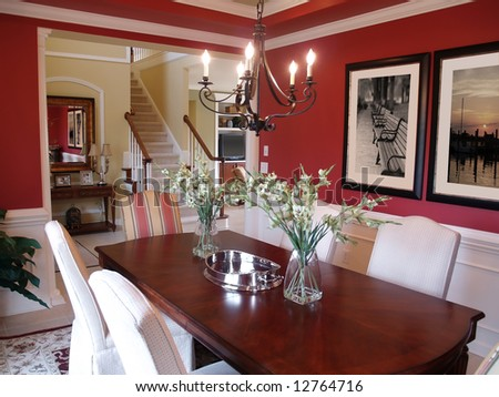 Well decorated formal dining room in a luxury home - stock photo