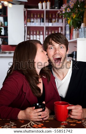 Well deserved kiss in a coffee shop - stock photo