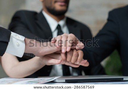 Well done business success. Close up of hands of confident and motivated business partners. Business concept