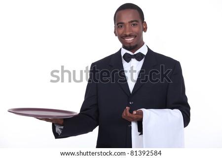 well dressed black waiter - stock photo
