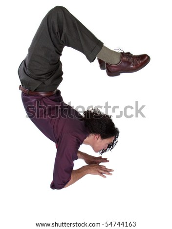 Well dressed  business man doing yoga, scorpion pose