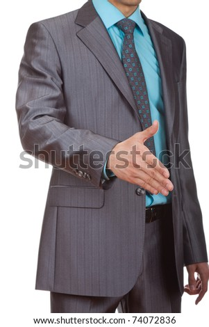 Well-dressed business man is giving a handshake with an open hand ready to seal a deal, isolated over white