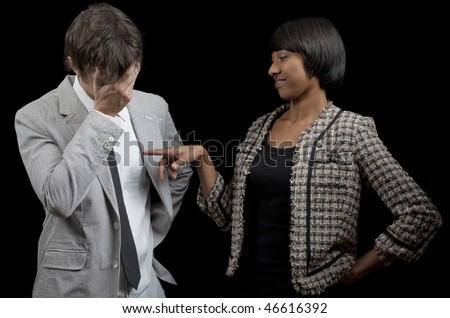 Well-dressed business woman criticizing badly-dressed employee. - stock photo