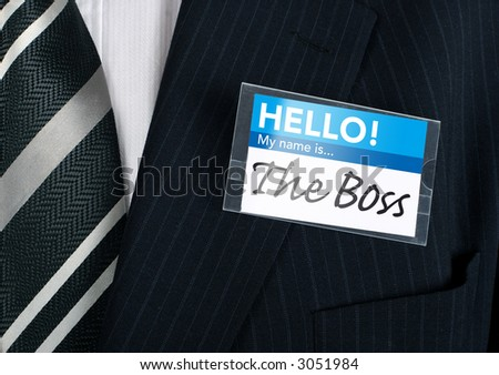 Well dressed businessman claiming to be the boss - stock photo