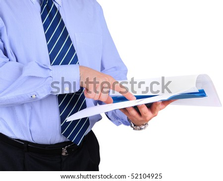 Well-dressed businessman is checking a project documentation - stock photo