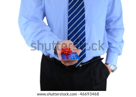 Well-dressed businessman is giving a present credit card - stock photo