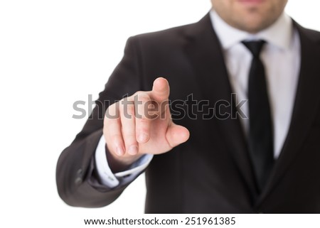 Well dressed businessman is pressing invisible virtual button. Cropped image, isolated on white background. - stock photo