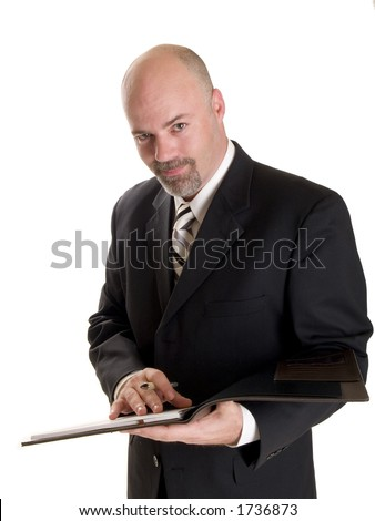 well dressed businessman taking notes in a notebook, isolated on white. - stock photo