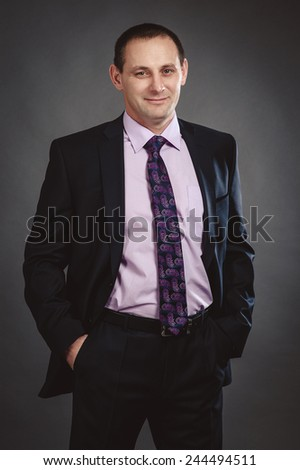 Well dressed confident man in suit - stock photo