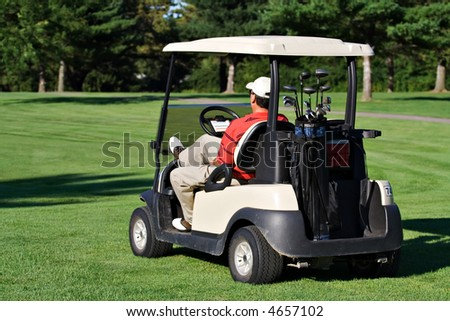 Well dressed male golfer waiting his turn to golf. - stock photo