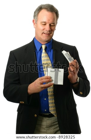 Well-dressed man in a business suit with unique gesture and expression - stock photo