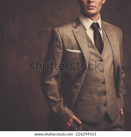 Well-dressed man in grey suit - stock photo