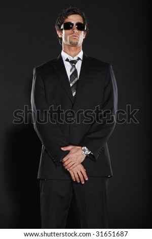 Well Dressed Man in Suit and Tie Wearing Sun Glasses - stock photo