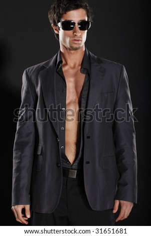 Well Dressed Man with Sun Glasses and Open Shirt - stock photo